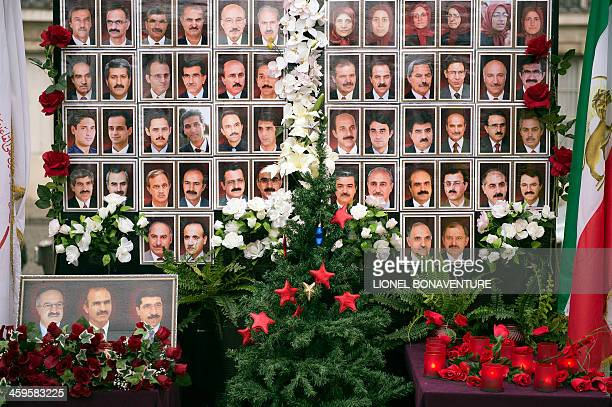A picture shows a makeshift memorial bearing pictures of members of the People's Mujahedin of Iran killed in recent attacks during a protest in Paris...