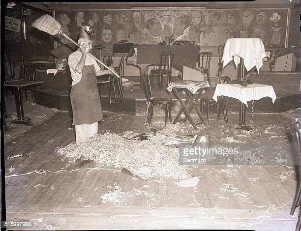 Picture shows a man cleaning up after another night of revelry welcoming in the New Year. Undated photo circa 1940s.