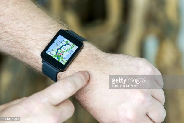 A picture shows a map appearing on a G Watch a smart watch produced by South Korean electronics company LG before it goes on sale to the general...