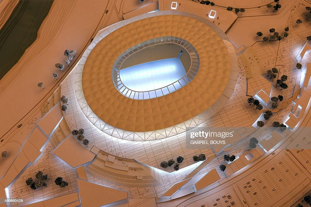 A picture shows a model of the Rome's new stadium project designed by US architect Dan Meis during a press conference on March 26, 2014 in Rome. AS Roma officially announced plans for a new, purpose-built 52,000-seater stadium that would end the Serie A club's shared tenancy of the Olympic Stadium with city rivals Lazio. Under American chairman James Pallotta, Roma, currently second in the league 11 points behind champions Juventus, are bidding to become 'one of the world's most successful football clubs', according to the club. Pallotta sees the move to the 'Stadio della Roma' to the south-west of the city as a major step in the Giallorossi's long-term strategy of challenging for titles at home and abroad.
