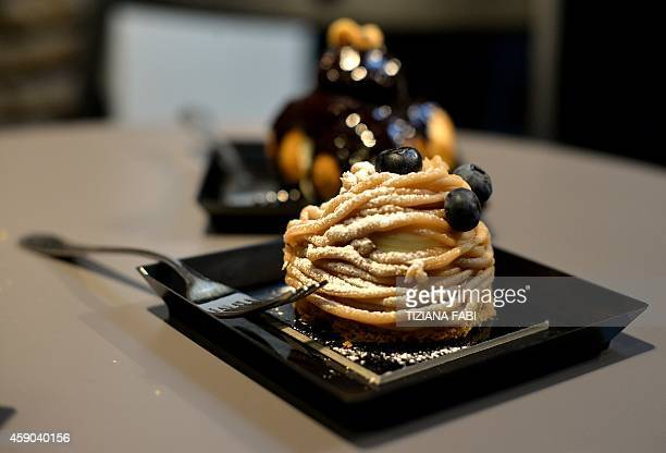 A picture shows a 'Mont Blanc' and 'profiteroles' in a pastries shop on November 14 2014 in Rome AFP PHOTO / TIZIANA FABI