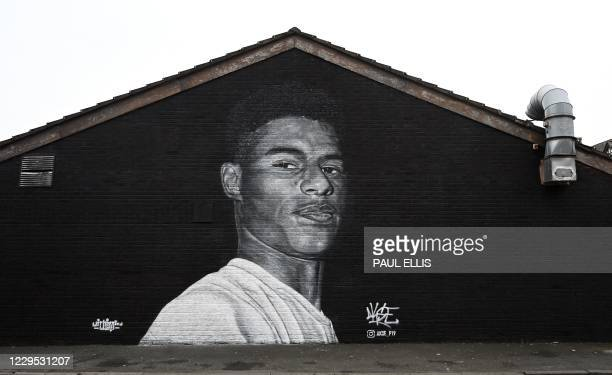 Picture shows a mural by grafitti artist Akse P19 of Manchester United football player Marcus Rashford on teh side of a building in Withington,...
