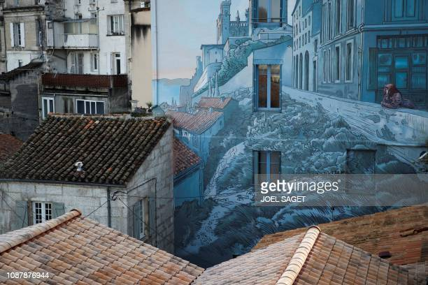 TOPSHOT A picture shows a mural entitled La fille des remparts after a drawing by French comic artist Max Cabanes in Angouleme western France on...