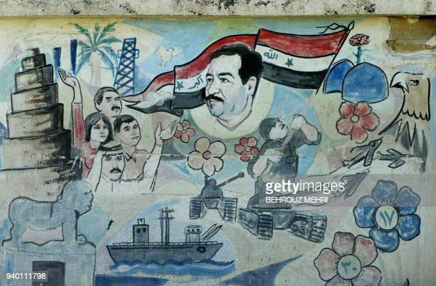 Picture shows a mural of Iraqi president Saddam Hussein and Iraqi flag inside on the wall of an Iraqi army base in the garisson town of Qarah Anjir,...