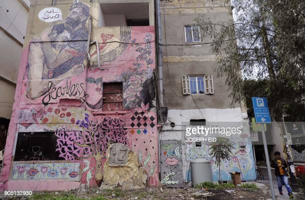 A picture shows a mural on a wall of a building in Ashrafiyeh on the eastern outskirts of the Lebanese capital Beirut on January 15 2018 The writing...