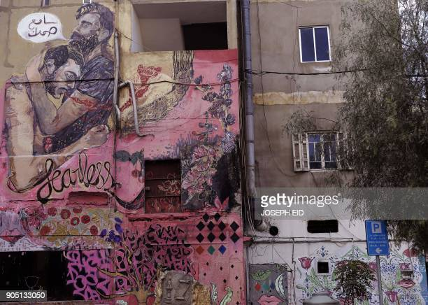 TOPSHOT A picture shows a mural on a wall of a building in Ashrafiyeh on the eastern outskirts of the Lebanese capital Beirut on January 15 2018 The...