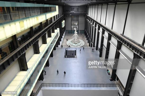 Picture shows a near-empty Turbine Hall at the Tate Modern in London on March 17, 2020 after the UK government announced stricter measures and social...