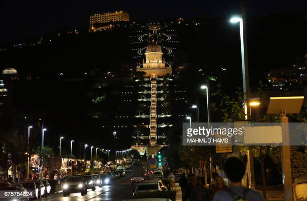 A picture shows a night view of the Bahai gardens and shrine in the Mediterranean city of Haifa in northern Israel on April 28 2017 / AFP PHOTO /...