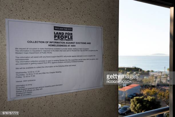 A picture shows a notice at the deserted Helen Bowden Nurses home where people live illegally as Robben Island prison where Mandela was jailed is...