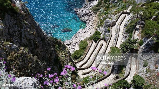 A picture shows a path to a small bay on Capri island in the Italian Gulf of Naples on May 22 2015 AFP PHOTO / DANIEL SLIM