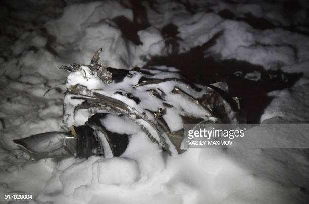 A picture shows a piece of debris at the site of plane crash in Ramensky district on the outskirts of Moscow on February 11 2018 A Russian passenger...