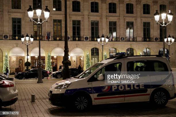 A picture shows a police car parked outside the Ritz luxury hotel in Paris on January 10 after an armed robbery Armed robbers made off with millions...