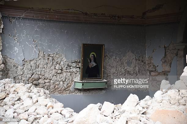 A picture shows a portrait of Santa Rita da Cascia in a small chapel partially collapsed in San Pellegrino near Norcia on November 2 2016 three days...