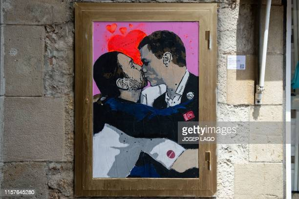 "Picture shows a poster by Italian urban artist Salvatore Benintende aka ""TVBOY"" representing Spanish far-left Podemos party leader Pablo Iglesias..."