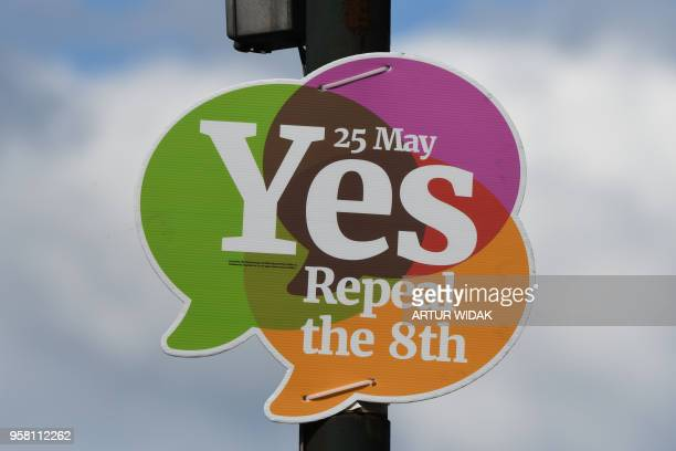 A picture shows a poster urging a 'yes' vote in the referendum to repeal the eighth amendment of the Irish constitution a subsection that effectively...