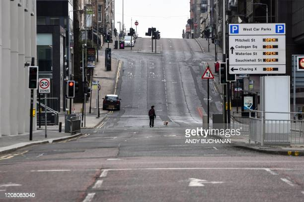 A picture shows a quiet street in Glasgow on March 24 2020 after Britain ordered a lockdown to slow the spread of the novel coronavirus Britain was...