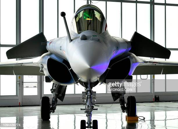 A picture shows a Rafale with Qatar's colours during a ceremony for the delivery to Qatar of the first of 36 Rafale multipurpose jet fighters from...