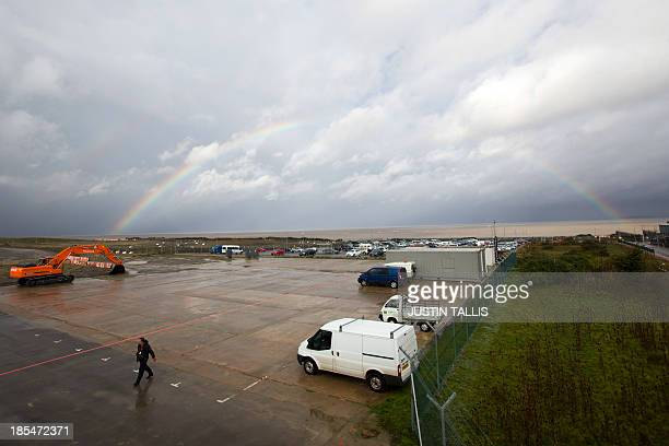 A picture shows a rainbow over development land where the reactors of Hinkly C nuclear power station at Hinkley Point will be built on the west coast...