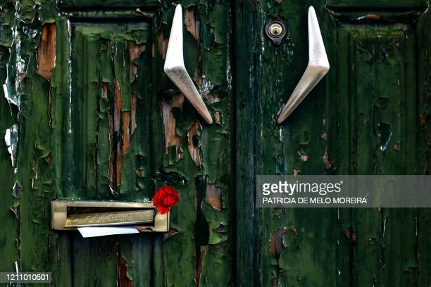 Picture shows a red carnation left in a residents' mailbox in Lisbon's Benfica neighborhood on April 25 marking the 46th anniversary of the...