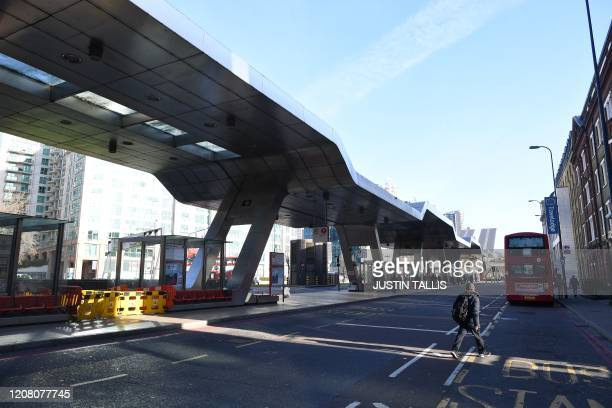 A picture shows a relatively quiet Vauxhall bus station in London in what would normally be the busy morning rush hour on March 24 2020 after Britain...