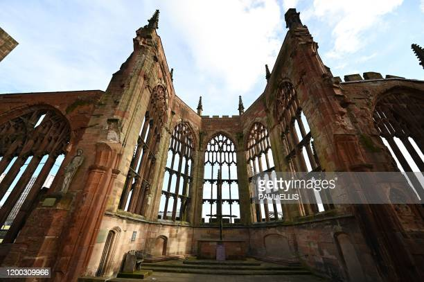 A picture shows a replica of the Charred Cross set up in the ruins of the bombed 14th century Gothic Coventry Cathedral in Coventry central England...
