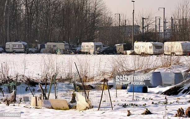 A picture shows a Roma camp covered by snow along a path called Chemin Napoleon and the rail track on January 22 2013 in Hellemmes near Lille...