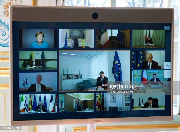 A picture shows a screen of a video conference call between members of the European Council seen at the Elysee Palace in Paris on March 26 to discuss...