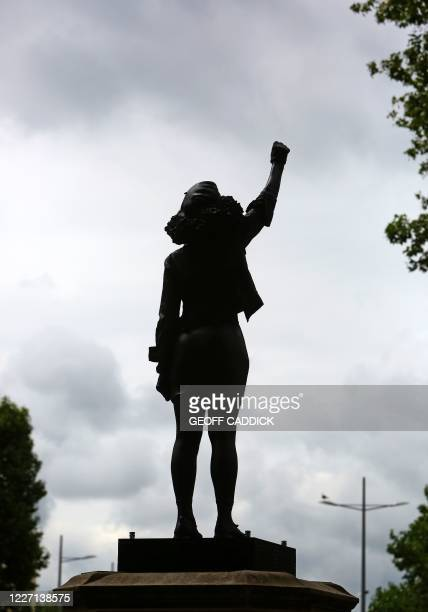 A picture shows a sculpture by British artist Marc Quinn in collaboration with Bristol resident Jen Reid showing Jen Reid with an arm raised in a...