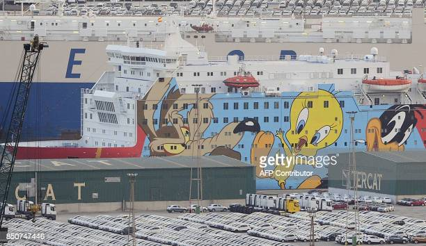 Picture shows a ship decorated with some 'Looney Toons' characters moored to the dock of Barcelona's port to house police reinforcements on September...