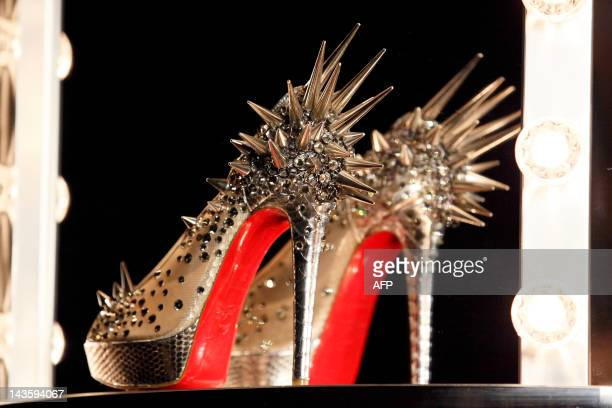 A picture shows a shoe at a preview of an exhibition by French shoe designer Christian Louboutin showcasing 20 years of the famous redsoled shoes at...