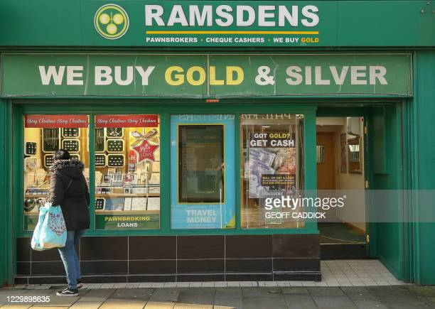 Picture shows a shop in the centre of town in Ebbw Vale, South Wales on November 26, 2020. - A huge silvery dragon brandishes its claws on the...