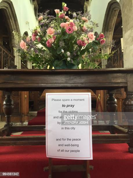 A picture shows a sign urging parishioners to pray for Dawn Sturgess and Charlie Rowley the couple poisoned by contact with the nerve agent Novichok...