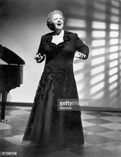 Picture shows a singer Kate Smith performing in a full length black evening gown Undated photo
