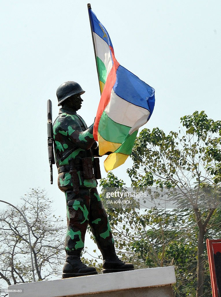 A picture shows a statue of a soldier holding a national flag, on December 29, 2012 in Bangui. Rebels in the Central African Republic, defying mediation efforts, on December 29, 2012 seized another town in their advance on the capital, forcing an army retreat and putting them just one town away from Bangui. The rebels, who already have control of four other regional capitals in the centre and north of the country, faced no resistance as they entered the town of Sibut around 150 kilometres (95 miles) from Bangui, a military official told AFP.