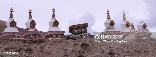 Picture shows a statue of Buddha which fell off last year during the earthquake at Changu Monastery , which has a history of 700 years, in Jiegu,...