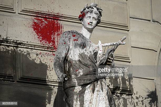 A picture shows a statue outside the Grand Theatre de Geneve opera house on December 20 2015 in Geneva after it was vandalised during a demonstration...