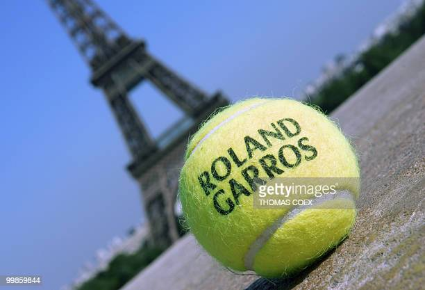 picture shows a tennis ball in front of the Eiffel Tour in Paris 19 May 2004 at RolandGarros in Paris before this season's second Grand Slam...
