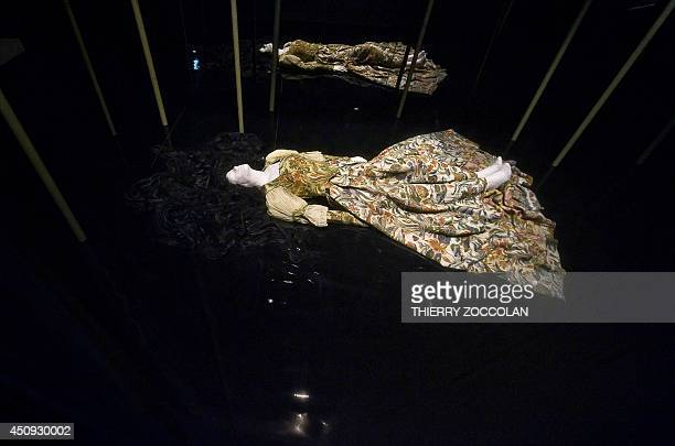 A picture shows a theatre costume in a room dedicated to Shakespeare's 'Hamlet' displayed at the National Centre for Stage Costumes in Moulins...