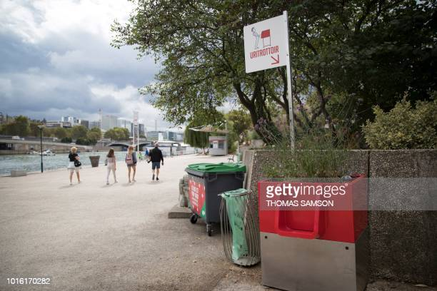 A picture shows a 'uritrottoir' public urinal on August 13 on the banks of the river Seine in Paris The city of Paris has begun testing...