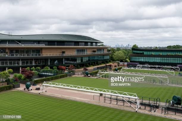 A picture shows a view from the Broadcast Roof overlooking the northern outside courts and No1 Court at the All England Lawn Tennis Club in west...