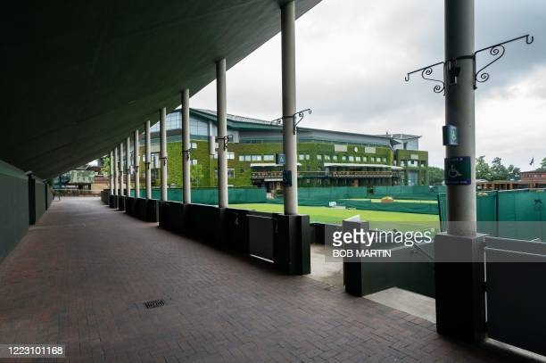 A picture shows a view of Court 4 overlooking Centre Court at the All England Lawn Tennis Club in west London on June 27 2020 the weekend before the...
