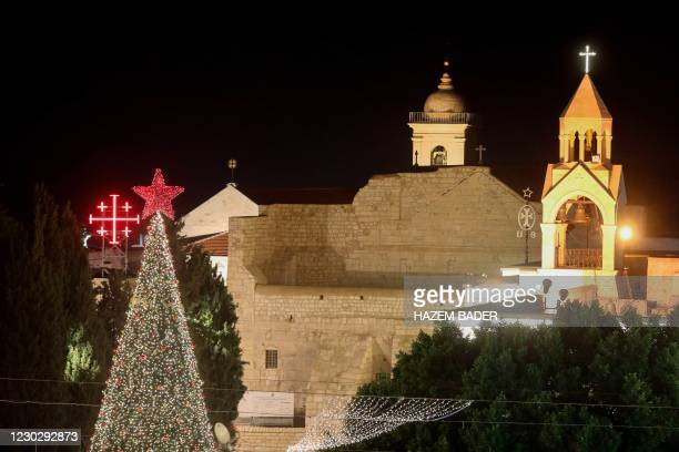 Picture shows a view of the Christmas tree at the Nativity Church square before the midnight mass, set to be held without congregation due to the...