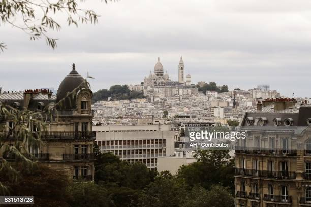 A picture shows a view of the Sacre Coeur Basilica atop the Montmartre hill seen from the ButtesChaumont Park in Paris on August 12 2017 The...
