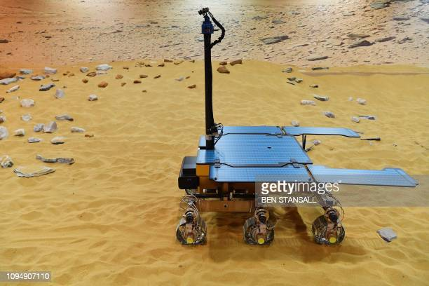 TOPSHOT A picture shows a working prototype of the newly named Rosalind Franklin ExoMars rover at the Airbus Defence and Space facility in Stevenage...