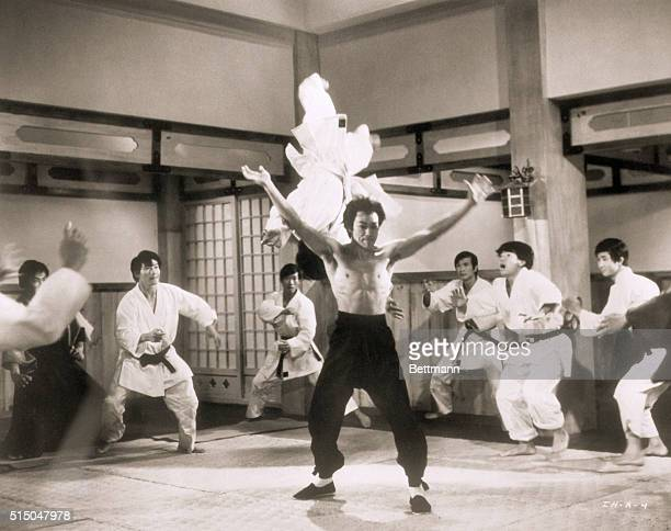 Picture shows actor Bruce Lee demonstrating a Kungfu flip in the air of a Japanese boxing club member from a scene in The Chinese Connection filed...