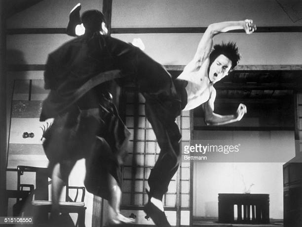 Picture shows actor Bruce Lee demonstrating a Kungfu kick in the air on the set of The Chinese Connection filed 5/27/73