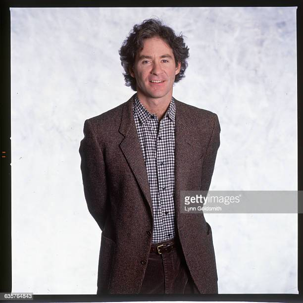 1989 Picture shows actor Kevin Kline standing in a tweed jacket and check shirt with his hands behind his back