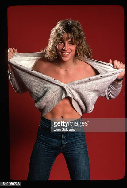 1979 Picture shows actor Leif Garrett posing in a studio while ripping his sweatshirt off
