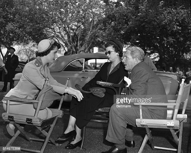 Picture shows actresses Joan Bennett and Elizabeth Taylor with actor Spencer Tracy on the set of the movie Father of the Bride Undated photo circa...