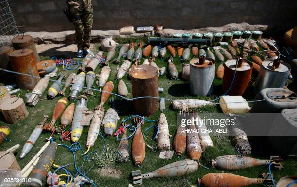 A picture shows ammunition mortar launchers and other type of explosives that were confiscated from Islamic State group jihadists in western Mosul on...